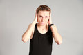 Male model covering ears with hands fashion shot of thin young in studio Royalty Free Stock Photo