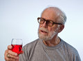 Male Model Holding A Glass Of Wine Royalty Free Stock Image