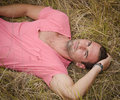 Male model relaxing, laid down in a field Royalty Free Stock Photos