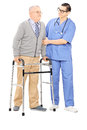 Male nurse helping a senior man with walker full length portrait of men isolated on white background Stock Photos