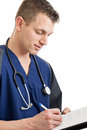 Male nurse taking notes Royalty Free Stock Photo