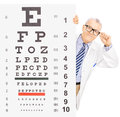 Male optician standing behind eyesight test isolated on white background shot with a tilt and shift lens Royalty Free Stock Images
