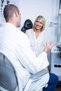 Male optometrist talking to female patient