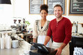 Male owner of coffee shop with female assistant Stock Photography