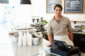 Male owner of coffee shop smiling to camera Royalty Free Stock Images