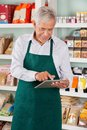 Male owner using tablet in supermarket happy senior digital Royalty Free Stock Images