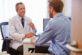 Male Patient Having Consultation With Doctor In Office Royalty Free Stock Photo