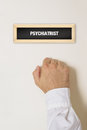 Male patient knocking on psychiatrist door for a medical exam Royalty Free Stock Photo