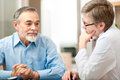 Male patient tells doctor his health complaints Royalty Free Stock Photography