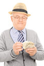 Male pensioner counting money isolated on white background Stock Photography