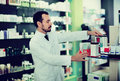 Male pharmacist looking for right medicine Royalty Free Stock Photo