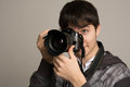Male photographer taking photos with DSLR digital camera Royalty Free Stock Photo