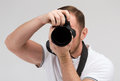 Male photographer taking picture with camera modern technology and people concept digital Stock Image