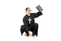 Male priest riding a small skateboard isolated on white background Stock Image