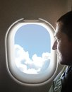 Male profile man looking into the window of the plane Royalty Free Stock Photos