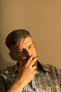 Male puffing on a cigarette picture of brunet Royalty Free Stock Images