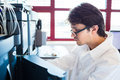 Male researcher carrying out scientific research in a lab shallow dof color toned image Stock Photo
