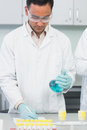 Male researcher experimenting in the lab carrying out experiments laboratory Stock Photos