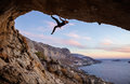 Male rock climber climbing along a roof in a cave Royalty Free Stock Photo