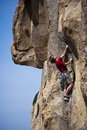 Male rock climber reaching for the summit. Stock Image