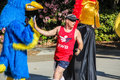 Male runner high fives woodpecker mascot in a charity race corvallis or may k for center against rape and domestic violence Stock Images