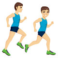 Male runner poses side view full body on two running with blue shirt and green trainers Stock Image