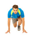 Male runner at the starting block before race full length portrait of determined over white background vertical shot Royalty Free Stock Photo