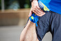 Male runner stretching Royalty Free Stock Photo