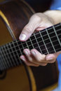 Male's hand on a classical guitar fretboard Royalty Free Stock Photo