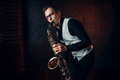 Male saxophonist playing classical jazz on sax Royalty Free Stock Photo