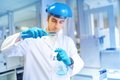 Male scientist learning and making experiments in chemical laboratory with liquid substances Royalty Free Stock Photo