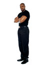 Male security guard with strong arms crossed