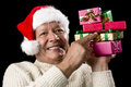 Male Senior Firmly Pointing At Six Wrapped Gifts Royalty Free Stock Photo