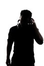 Male in silhouette listening to headphones isolated on white background Royalty Free Stock Photography