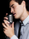 Male singer singing with old fashioned microphone Royalty Free Stock Photos