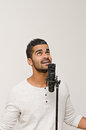 Male singing portrait of in to microphone Royalty Free Stock Photo