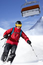 Male skier back country is skiing under the gondola Stock Photo