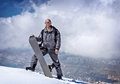 Male snowboarder in the mountains Royalty Free Stock Photos