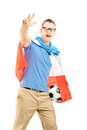 Male sport fan with flag of holland holding a ball and gesturing soccer isolated on white background Stock Photography