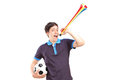 Male sport fan holding a football and horn isolated on white background Royalty Free Stock Photo