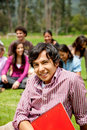 Male student outdoors Royalty Free Stock Image