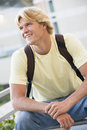 Male student outside wearing rucksack Stock Photography