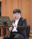 Male student  play clarinet Royalty Free Stock Photo