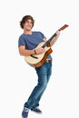 Male student posing while playing guitar Stock Photography