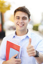 Male student showing thumbs up portrait of young man smiling Stock Photos