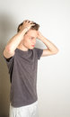 Male styling his hair Royalty Free Stock Photo