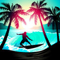 Male surfing at sunrise at a tropical beach Royalty Free Stock Photo