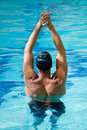 Male swimmer stretching Royalty Free Stock Images