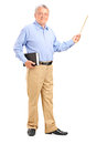 Male teacher holding a wand and book Royalty Free Stock Images