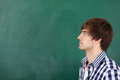 Male teacher thinking in front of chalkboard portrait handsome young Royalty Free Stock Photo
